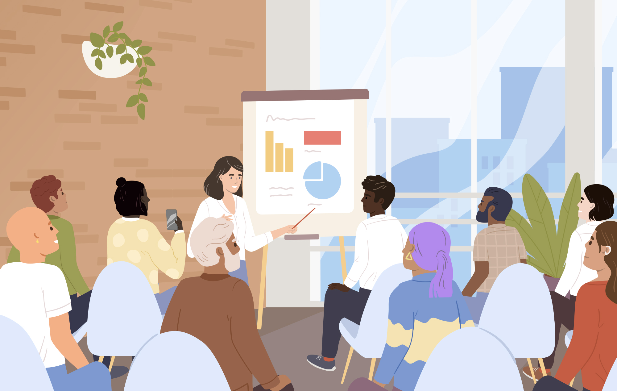 A group of people sitting in a room watching a presentation—the presenter stands at an easel and points to data.