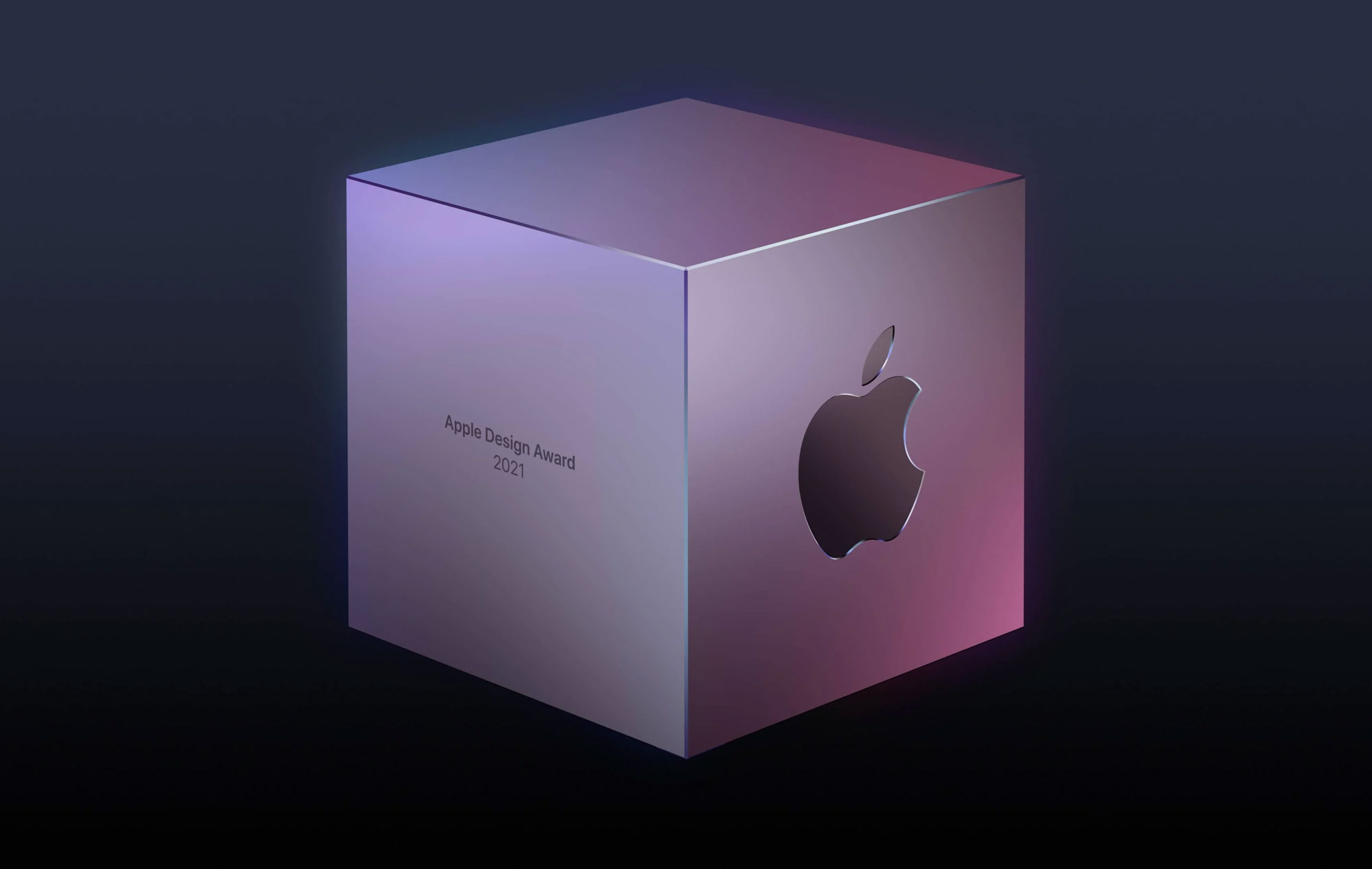 Silver cube with a purple glow. On the right side of the cube is the Apple logo and on the left side is text that says, Apple Design Award 2021