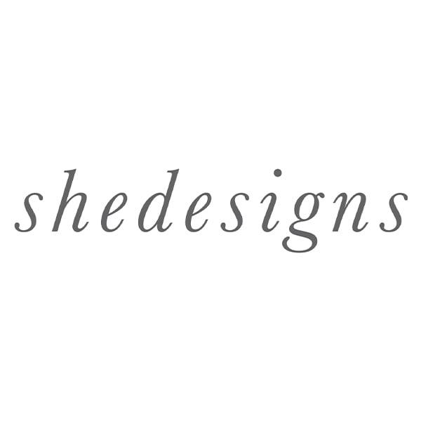 She Designs logo